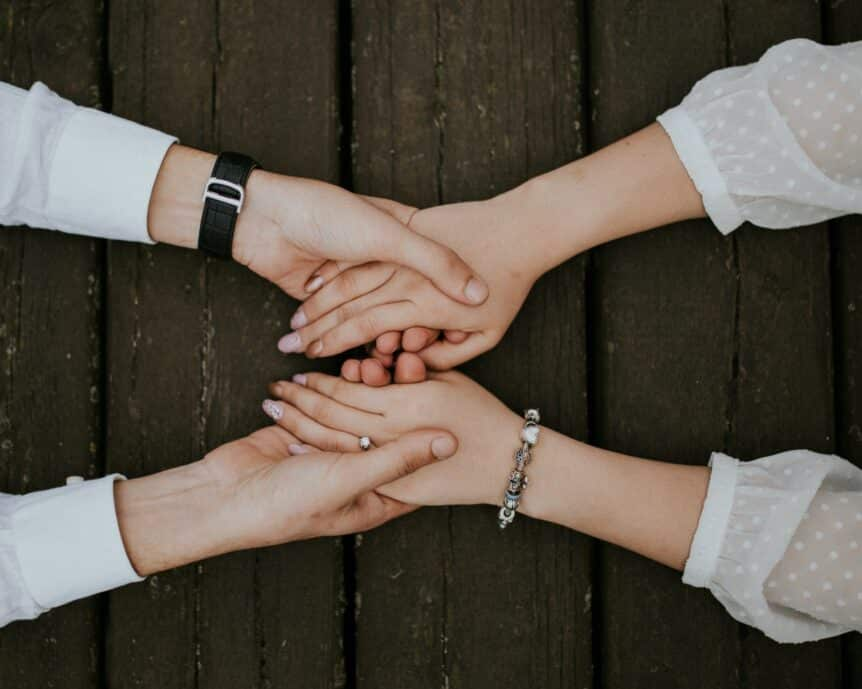 Holding hands to show how to stay connected, hosted by Wellin5
