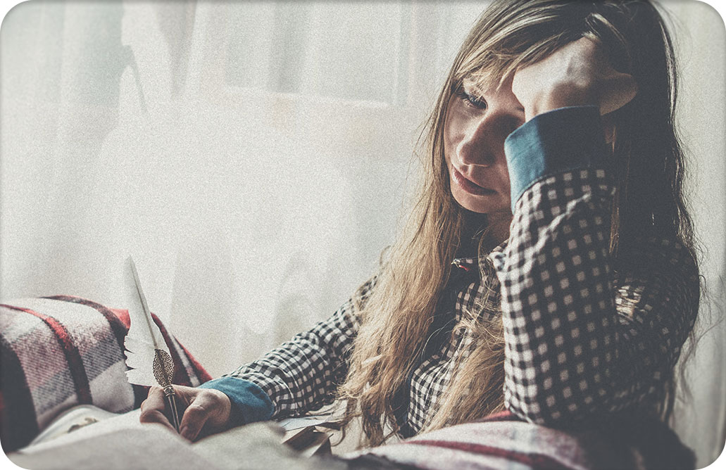 sad looking woman writing