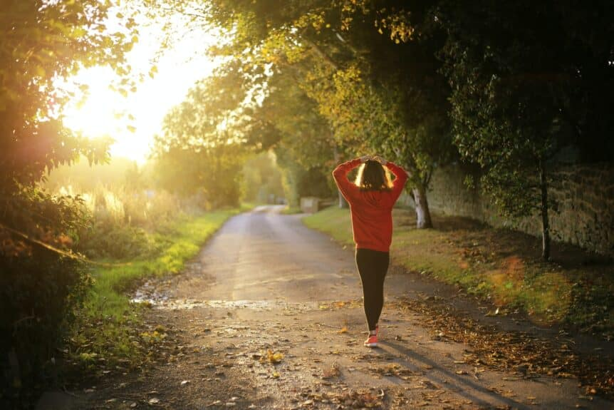 A woman going for a walk to manage burnout, hosted by Wellin5